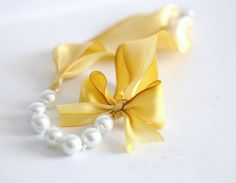 Yellow and pearl bracelet