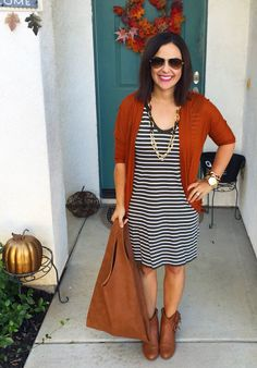 Fall style, teacher outfit, ootd inspiration. Olive stripe dress, orange cardigan, fringe ankle boots.