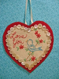 "I stitched up a little vintage birdy image and added the words ""Love YOu""--a little red wool and some pretty buttons!!  What a way to say I love you!"