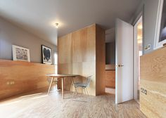 New flat squeezed into the top of two Victorian homes.