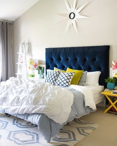 House Tour: A Room For Every Taste | Wayfair.ca Dark blue velvet headboard