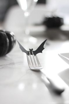 Add a subtle spooky touch to your Halloween wedding decor with a bar table setting.