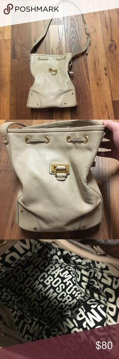 {Marc Jacobs} Beige Leather Tote GUC. 100% cow leather. Tiny markings on the front but can be cleaned off. Inside is in great condition! Comes with a free dust bag. Marc By Marc Jacobs Bags Hobos