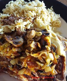 T- bone steak with fried onion and mushroom done in butter with noodles #steak