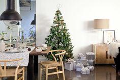 Mesa de Navidad en clave nórdica: los tonos gris, visón y verde le cambian la onda a la Nochebuena y refrescan la tradición.