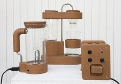 Short Circuit (Gaspard Tine-Beres, 2012): A range of kitchen appliances made using recycled electrical discarded or damaged appliances, reclaimed materials, and natural cork.