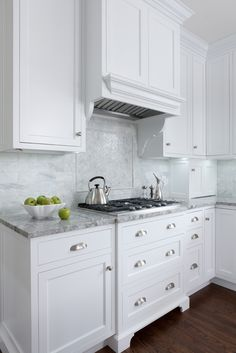 White Inset Cabinets, Super White Counters, Marble Backsplash, Dark Wood  Floors. MB