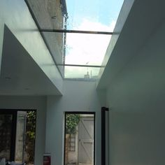 Lightwell & Lean-to Roofs · 1st Folding Sliding Doors House Extension Design, Roof Extension, Extension Ideas, Flat Roof Skylights, Lean To Roof, Roof Lantern, Roof Light, Glass Roof, House Extensions