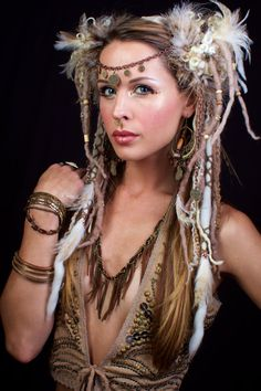 This beige dreaded beauty is packed full of beautiful natural treasures! Brass toned coins line your forehead, with draping chains that hang on both