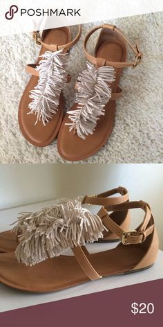 Tan fringe sandals Perfect for summer! They're a tan sandal with cream colored fringe running down the center. They have straps across the middle of the foot and around the ankle. Worn once. Old Navy Shoes Sandals