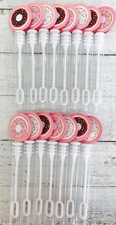 This listing is for 15 Donut inspired bubble wands as seen in photo 1 (Pink, Brown & White frosted donut images). Choose your background cardstock color, blue or pink. Additional photos show coordinating items for sale to complete your party theme. Custom orders available, please contact