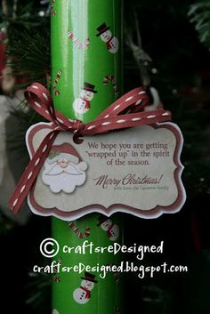 "Another easy Christmas gift for neighbors, teachers, whoever - wrapping paper with a cute tag that says ""We hope you are getting 'wrapped up' in the spirit of the season!"" (Printable tag!)"