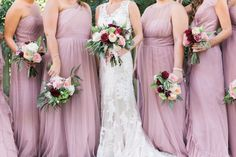 The Bride and her bridesmaids standing together in their mauve and ivory gowns before walking down the aisle.  See more here: http://joymichellephotography.com