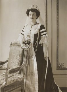 Lady Aimee Michelham, nee Bradshaw, 1911. Wearing a massive diamond and emerald tiara with circa seven large 'heart-shaped' motifs, on the occasion of the Coronation of George V.