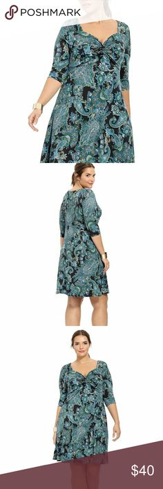 Pretty in Paisley knot front dress I just got this and it's super pretty, but my pea brain bought the wrong size, so now you can look like a million bucks. I tried to make it work but I just couldn't do it. My mistake is your gain. Excellent used condition. Lucie Lu Dresses Midi