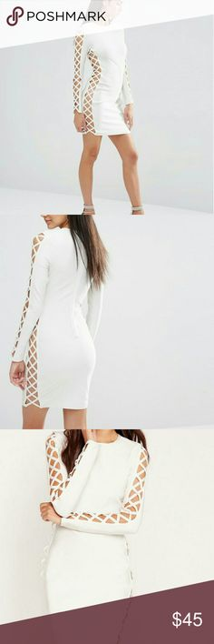 Missguided Premium Bandage Lace Upside Dress Missguided crossed side bandage dress. This dress is gorgeous. Its definitely for that bold woman. Long sleeved and crossed sides go from the hem of the dress to the arm pit. This is a bandage like material dress. Worn once. Missguided Dresses Long Sleeve