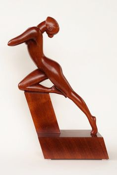IN OUTBURST is a beautiful artistically stylized nude woman wood sculpture 100% hand-crafted from a solid piece of Mahogany wood. The sculpture has the warm organic velvety texture. It is one of a kind. Approx. size: 18`` x 12`` x 4``. Varnish: transparent lacquer, not stained.