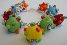 Pok a Dot Handmade Lampwork bead Cha Cha Charm by perlesdeverre,
