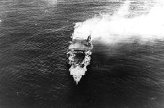 The heavily damaged, burning Japanese aircraft carrier Hiryu, photographed by a plane from the carrier Hosho shortly after sunrise on June 5, 1942. Hiryu sank a few hours later.