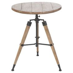 """Tripod-style wood end table with metal accents.Product: Accent table Construction Material: Wood and metal Color: Natural  Dimensions: 30"""" H x 24"""" Diameter    Cleaning and Care: Wipe with dry cloth    jossandmain.com"""