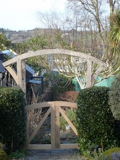 new oak gates for an oak double archway I made in 2009. By www.artofoak.co.uk