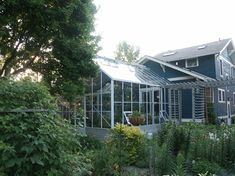 White Gable Attached Greenhouse