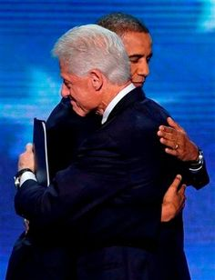 (AP Photo/J. Scott Applewhite). Former President Bill Clinton hugs President Barack Obama after President Obama walked on stage after Clinton's speech the Democratic National Convention in Charlotte, N.C., on Wednesday, Sept. 5, 2012.