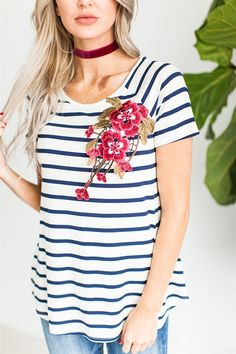 Our Floral Embroidery Patch Stripe Top is the perfect go to top this season! Featuring the softest material, a stunning embroidery detail, and flattering horizontal stripes.
