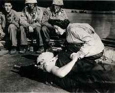 """Flight nurse Jane Kendeigh caring for wounded soldier on Iwo Jima--1945"""