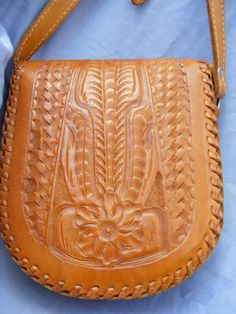 Hey, I found this really awesome Etsy listing at https://www.etsy.com/listing/107409485/tooled-leather-vintage-purse