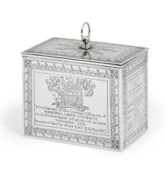 A George III silver tea-caddy – Mark of John Edward Terrey, London, 1817 - Engraved on one side with a coat-of-arms below a viscount's coronet & with an inscription, the other side engraved with a list of the ships involved in the capture of Algier, the short sides engraved on one side with a depiction of the capture & further ships involved in the capture, marked near rim, inside cover & underneath, 4¾ in. W. The arms are those of Pellow for Edward Pellow, 1st Viscount Exmouth (1757-1833)