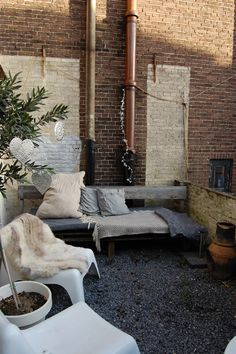 small terrace: bench, ikea stools and some pots