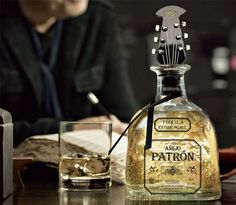 If It's Hip, It's Here: Patrón Añejo Holiday 2012 Guitar Bottle Stopper by John Varvatos. - If I still have a significant other come Xmas, he is getting this guitar head tequila bottle stopper.