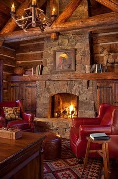 Rustic Living Room with Built-in bookshelf, Fireplace, stone fireplace, High ceiling, Hardwood floors, Exposed beam