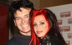 Gary Numan married his soulmate, Gemma who happened to be the head of his UK fan club. It was a love that was meant to be. She is the one who discovered Gary's Aspergers as her brother also suffers from it. It's so nice to see him smile after years of serious images of him. He hated his teeth. ;)