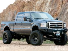 Check out this 2005 Ford F250 Super Duty with a Power Stroke diesel engine, a Fabtech suspension lift, a JL Audio subwoofer and amp, and BFGoodrich Mud Terrain tires, only on 8-lug.com, the official website of 8-Lug magazine.