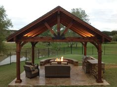 This beautiful yet rustic freestanding post and beam pavilion provides the perfect spot to entertain in the rain or sun. #pergolafirepit