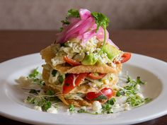 Join Glenmorgan for dinner and start with the Chef's special Crab & Avocado #Tostada, layered with jumbo lump crabmeat, sliced avocado, wonton crisps, micro greens, queso fresco, and pickled red onions.