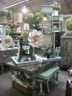 Ramshackled Treasures another great store to shop at in Zimmerman, mn. I love how everything is either neutral or aqua, and the large flowers draw the eye around the booth Flea Market Displays, Flea Market Booth, Vendor Displays, Craft Show Displays, Flea Markets, Display Ideas, Retail Displays, Merchandising Displays, Vendor Booth