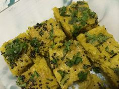 Khaman recipe by Aarifah posted on 21 Jan 2017 . Recipe has a rating of by 1 members and the recipe belongs in the Vegetarian recipes category Indian Food Recipes, Vegetarian Recipes, Food Categories, Mustard Seed, Baking Pans, Zucchini, Fries, Snacks, Vegetables