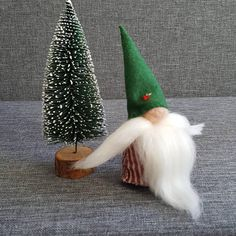 A Scandinavian gnome The body and hat are crafted from soft felt and filled with polyester wool stuffing. The nose is needle felted with wool. The beard is also from wool. Height: ~ 14cm Please follow us: https://www.instagram.com/mahsacrafts/ https://www.facebook.com/MahsaCrafts/