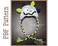 This is a crochet pattern for the Silly Milly and Silly Milo Monster Hat. Striped or solid body, colorful scales, and a silly smile make this such a fun hat for your monsters! hats! Big and small monsters, boy and girl monsters, make a silly faced monster for everyone you know. {P A T T E R N • O N L Y} - - - - - - - - - - - - - - - - - - - - - - - - - - - - - - - - - - - - - - You are NOT purchasing a finished hat; you are purchasing a PDF file with instruction to crochet your own. If y...