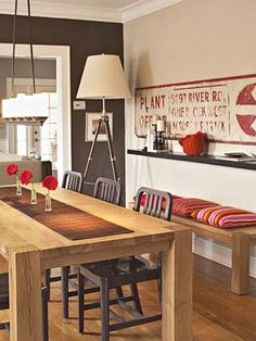 wood table + metal chairs + cool sign + gray walls. I don't like the shelf on the wall . . .
