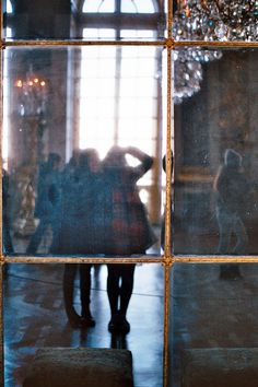 Looking through a window into the Great Hall of Mirrors, Palace of Versailles, France