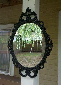 Ornate Oval Mirror in Vintage Metal Frame - 17 x 12 inch Handpainted Brass in Jet Black. $69.00, via Etsy.