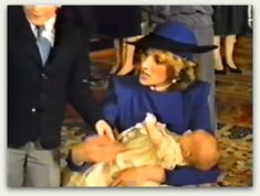 Princess Diana and Prince Harry at his Christening. She doesn't look too happy.