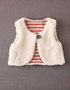 I've spotted this @BodenClothing Reversible Fleecy Vest Oatmeal/Red Stripe 6-12 months