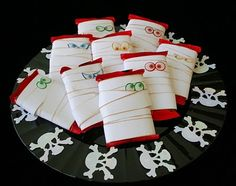 """Mummy Treats                                                              Instructions:  1. Cut 1"""" strips of white paper  2. Tape four 1"""" x 12"""" strips together   3. Ink the edges with brown ink and the blending tool  4. Tape one end of paper to the back of Kit-Kat   5. Wrap the paper around the Kit-Kat   6. When finished, tape the other end to the back of Kit-Kat   7. Apply spooky eyes"""