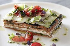 Raw zucchini lasagne with pesto, olives and tomato - the photo  makes the dish look very tempting...