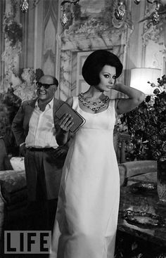 Sophia Loren At Home With Carlo, 1964         In the summer of 1964, Eisenstaedt visited Loren and her husband at the home Carlo Ponti had spent years restoring: an opulent, ancient, 50-room villa in Marino, Italy. Here, the elegant Loren -- wearing a Dior gown and a diamond-and-ruby necklace -- stands in front of her husband in the main living room, which featured fresco walls and made-to-order Italian furniture. Though she loved the house -- at the time of Eisie's visit, she called living…